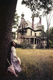 1960s-1970s Woman Standing Beside Tree Front of Abandoned Haunted Victorian House