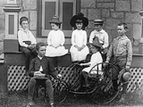 1890s-1900s Seven Children Sitting on and around Porch One Girl on Old Fashioned Tricycle