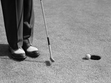 1950s Man Knees Down Putt on Golf Green