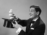 1960s Profile Magician Man Pulling 4 Eggs Out of Hat Holding Them Between Fingers