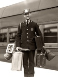 1930s-1940s Man Red Cap Porter Carrying Luggage Bags Suitcases Passenger Railroad Train