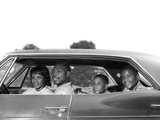 1960s Family Sitting in Four Door Sedan Automobile