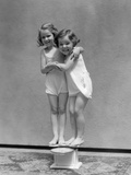 1930s Two Little Girls Standing on Scale Arm in Arm Smiling