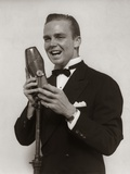 1920s-1930s Man Radio Singer Entertainer Crooner in Tuxedo Singing into Microphone