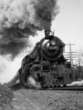 1920s-1930s Steam Engine Pulling Passenger Train Smoke Billowing from Exhaust Stack