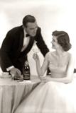 1950s Formal Dress Couple Man in Tuxedo Woman Wearing Gown Holding Champagne Glass