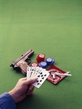 1970s Man Holding Royal Straight Flush in Spades Playing Cards with Semi-Automatic Pistol