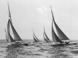 Six Meter Sailboats Leaning in Race