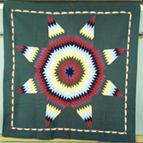 An Amish Star of Bethlehem Coverlet