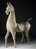 A Massive Sichuan Gray Pottery Figure of a Striding Horse