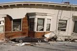 Quake-Damaged Apartment House on a Car