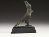 An Egyptian Bronze Figure of a Falcon