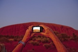 Tourist Photographing Ayers Rock in the Australian Outback
