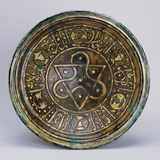 A Late Mamluk Pottery Dish  the Central Roundel Decorated with a Triangular Motif