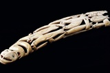 An Eskimo Carved Walrus Ivory Tusk with Various Spirit and Animal Figures