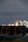 Space Shuttle Discovery Lifting Off and Countdown Clock