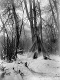 A Tepee in a Snow Covered Forest