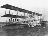 Passengers Standing on Middle Wing of Triplane