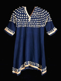 A Hunkpapa Sioux Girl's Dress of Blue Wool Cloth Trimmed with Cowrie Shells