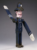 A Polychrome Wood and Metal Whirligig Modelled as a Police Sergeant