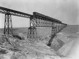 Train Crossing Bridge over Dam