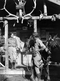 1920s-1930s Couple and Horses in Front of Western Hunting Lodge Porch with Trophy Antlers Skulls