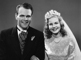 1940s Portrait of Bride and Groom Linked Arm in Arm