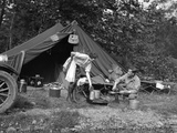 1920s Couple Man Woman on Fishing Camping Trip Vacation at Campsite Man Cooking over Fire