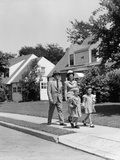 1940s Family Walking on Sidewalk in Front of House
