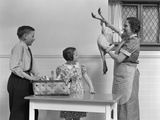 1940s Housewife in Kitchen Showing Plucked Turkey to Children