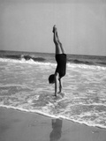 1920s Woman Doing a Handstand in Ocean Surf