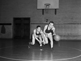 1930s Two Boys Playing Basketball Inside Court Dribbling Basketball