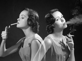 1960s Multiple Exposure Two Views Brunette Woman Smoking a Cigarette Lighting it and Exhaling Smoke