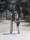 Child Reaching into Mailbox