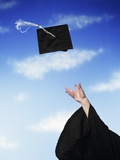 Graduate Tossing Mortarboard Hat into the Air