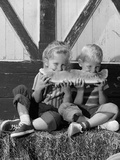 1960s Boy and Girl Sharing a Slice of Watermelon