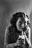 Girl Sipping a Soda