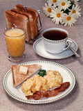 Scrambled Eggs Bacon Toast on Dish Glass Orange Juice Toast in Rack Cup of Coffee Daisies Breakfast