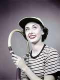 1950s Smiling Brunette Woman Holding Tennis Racket Wearing Striped T-Shirt and Sports Cap