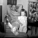 Dad Relaxes and Smokes His Pipe with His Four Year Old Daughter  Ca 1958