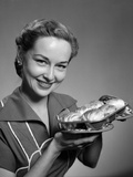 1950s Smiling Woman Holding Freshly Baked Rolls