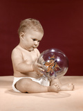 1960s Baby Sitting Holding Clear Plastic Toy Ball with Butterflies Inside