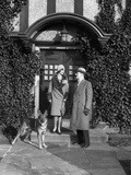 1920s Couple Wearing Coat Hat Gloves on Steps Ivy Covered Building with German Shepherd Dog