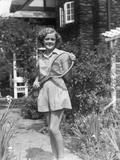 1930s Teen Girl Brunette on Sidewalk of House Holding Tennis Racket Wearing Shorts