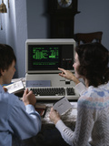1980s Couple Working at Apple III 3 Home Computer Paying Bills
