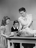 1940s Mother Son Daughter in Kitchen Stuffing Turkey for Thanksgiving Dinner