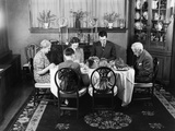 1940s Extended Family Sitting around Dining Room Table Saying Grace before Thanksgiving Dinner