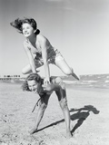 Girls Playing Leapfrog on Beach