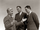 1940s One Man Telling Story to Two Other Men Using Hand Gestures