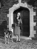 1920s Fashionable Smiling Woman Wearing Cloche Hat Coat with Fur Trim with a German Shepherd Dog